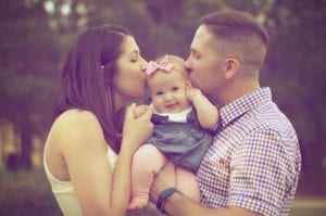 Couple Kissing Baby - dentist asheville